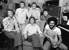 Georgie Fame & The Blue Flames with Georgie Fame (centre, on chair) and Brian Bennett (2nd left) on August 8 1974