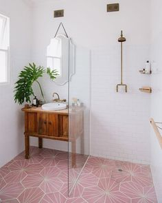 Try a glass pane to separate the shower area without breaking up visual flow. (📷: Link in bio for more soothing bathroom ideas. Boho Bathroom, Rustic Bathrooms, Downstairs Bathroom, Bathroom Colors, Bathroom Sets, Small Bathroom, Bathroom Pink, Industrial Bathroom, Unit Bathroom
