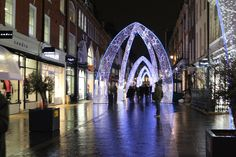 Christmas in the United Kingdom : LONDON - DECEMBER 21st 2014: Christmas lights on South Molton Street, in Mayfair in London. The lights will remain in place until the New Year.