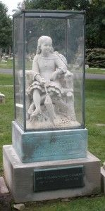Graceland Cemetery, Chicago...In 1880, six-year-old Inez Clarke was struck and killed by a bolt of lighting. Her parents commissioned an artist to create a sculpture in her exact likeness and placed it over her grave, adding a transparent plexiglass box to protect it from the elements.