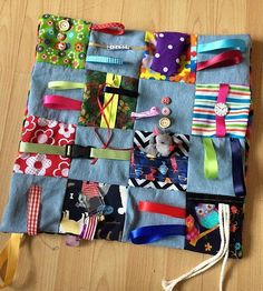 .Fidget blankets/quilts can be a soothing solution to the restlessness, fidgeting and anxiety that often comes with Alzheimers/ Dementia These are made in a soft denim , WHEN ORDERING PLEASE STATE IF YOU WANT ALL DENIM OR A DENIM MIX THANK YOU My dementia fidget blankets are