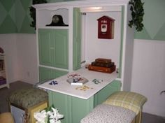 Old Armoire or Entertainment Center   -  made into a drop-down desk/table/sewing center.  Such a good idea!