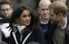 Harry and Meghan shook hands and greeted around 300 well-wishers and schoolchildren ently ...