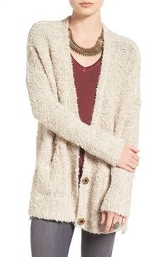 Free shipping and returns on Free People Bouclé V-Neck Cardigan at Nordstrom.com. A touch of alpaca adds luxurious softness to a comfy-casual bouclé-knit cardigan in a perfectly drapey shape. Hidden front snaps secure the cozy style and create a deep V-neckline that shows off your layering.