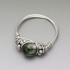 This ring is uniquely hand-crafted with 22 gauge sterling silver round wire, 4x5mm sterling silver Bali beads, and a 6mm Seraphinite round bead. I make this ring to order. The ring pictured is a representation of what you will receive. **The photos make the beads look much larger than #SterlingSilverWire #wireringswithbeads