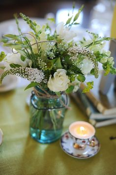 Making DIY candles in tea cups for centerpieces