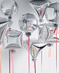 "Let these puffed-up balloons loose and any gathering is transformed into a veritable bash. We swapped out string for wide satin ribbons in cheerful colors. Sticky gift-wrap pom-pom bows placed beneath each balloon cinch the celebratory look. Silver balloons, in Orbz, Cubez, and Diamondz, partycity.com Crystal bows, 3½"", in Silver, papermart.com Brasserie chairs, in White, serenaandlily.com"