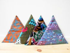 These are pillows, but I think covering wood blocks in fabric and hanging them on a wall could be neat decorations. Textile Patterns, Print Patterns, Triangle Pillow, Texture, Decoration, Making Ideas, Pattern Design, Arts And Crafts, Kids Rugs