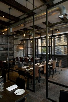 The open steel partitions provide visual separation without blocking views or natural light. Although an industrial feel, this restaurant is still elegant and inviting.