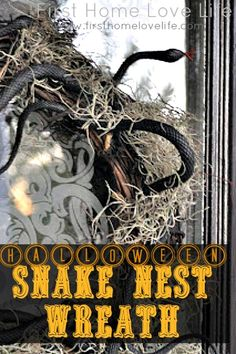 DIY Halloween scary grapevine wreath wrapped in moss and rubber snakes to make nest. Creepy and Spooky!