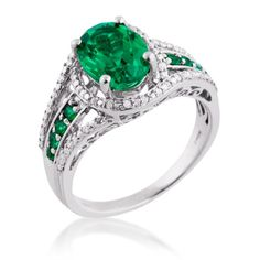 Ladies Created Emerald and Diamond Ring in White Gold