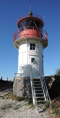 The Old Lighthouse Gellen on Hiddense, Germany.  It was built in 1904 from cast sections and became fully operational in 1907. This lighthouse marks the northern entrance of the Gellenstron.  Hiddensee is a car free island in the Baltic Sea, Germany.