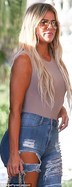 Wow factor:The stunning Keeping Up With The Kardashians star showed off her fresh tan and golden locks while out in the Florida city with her new love