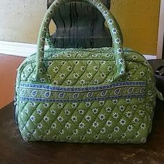 """Vera Bradley Satchel Super cute little Vera Bradley Satchel in a pretty green, blue and white floral print. Shaped like the speedy with a zip top. Interior has a zipper pocket. A little faded and corners show slight wear. Strap drop 5"""". Vera Bradley Bags Satchels"""