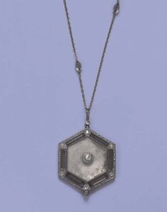 A BELLE EPOQUE DIAMOND, ROCK CRYSTAL AND AMETHYST PENDANT WATCH   The hexagonal engraved rock crystal with diamond cluster centre within six amethyst panels to the diamond border, reverse enclosing a circular watch with Arabic numerals, blued steel hands and white dial, suspended from a fine link chain with engraved rock crystal beads, circa 1910, pendant 4.3 cm. high