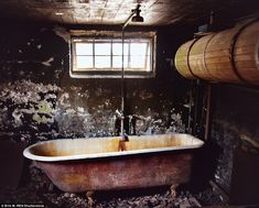Värmland, Sweden. Stepping inside the house the photographer found the bathroom, bereft of paint or other de...