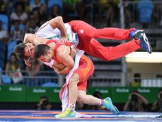 Coach throw:    Serbia's Davor Stefanek celebrates by tackling his coach after defeating Armenia's Migran Arutyunyan in the the men's wrestling Greco-Roman 66-kg gold medal match Aug. 16.