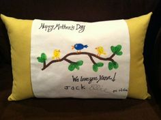Creative and unique Mother's Day gift idea!  MyDesign Pillow (see Facebook page -- MyDesign Pillow) with a blank wrap.  Birds and leaves made from kids' thumbprints and acrylic paint, details and writing done with fabric markers.  The wrap buttons onto the pillow and is reversible --- so it has another side for more artwork. Create a gift any mother would love!    ...BTW, you may want to visit:   http://artcaffeine.imobileappsys.com