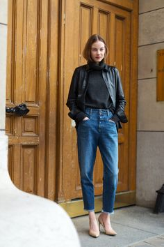 cropped jeans with tucked in black blouse and leather jacket