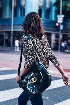 Annabelle of Viva Luxury toting a Gemini Link Shoulder Bag