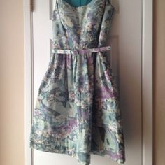 SALEEliza J Watercolor Floral Dress Retro inspired fit dress in green, blue, and purple watercolor floral print.  Removable matching belt (one belt string is broken but still attached). 100% polyester (the texture is very unique, feels a bit like a raincoat). Fully lined. ⛔️Price is firm even when bundled. No trades.⛔️ Eliza J Dresses
