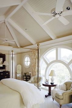 Traditional Master Bedroom with English Victorian Cast Iron Four Poster Bed, Crown molding, Ceiling fan, Carpet, High ceiling