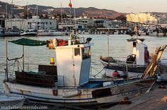 Small fishing boat in fishing port Marbella sunset