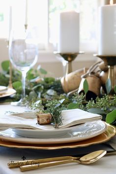 Gorgeous holiday table setting with greens, eucalyptus and gold accents! Classic Christmas table in gold and white---> French Country Christmas, Country Christmas Decorations, Christmas Table Settings, Nordic Christmas, Christmas Tablescapes, Holiday Tables, Simple Christmas, Christmas Holidays, Christmas 2019