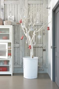 Painted branch Christmas tree! Maybe a cheap idea for our first Christmas?