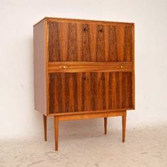 Robert Heritage; Rosewood and Mahogany Drinks Cabinet for Archie Shine, 1960s.