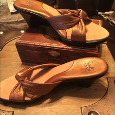 Sofft Sandals Very comfortable faux leather metallic gold/bronze hue sandals accented with 2 straps with center knots. 2in heels, little to no bottom ware. Slight wear the back of left heel otherwise spotless & like new. Worn only once. Sz 7. Sofft Shoes Sandals