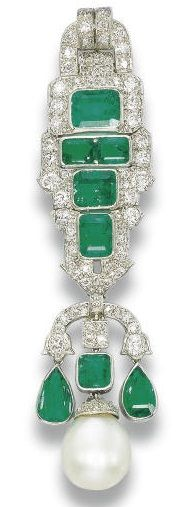 AN ART DECO EMERALD, NATURAL PEARL AND DIAMOND BROOCH, BY BULGARI. The geometric articulated panel set with rectangular-cut emeralds and old-cut diamonds, suspending a natural drop pearl, flanked by a pear-shaped emerald pendants, mounted in platinum, circa 1925, 8.0 cm long, in a Bulgari fitted pink leather case. #Bulgari #ArtDeco #brooch