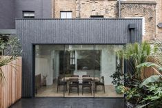 Rugged stripes of Welsh slate complete the rear extension to this remodelled Victorian house, designed for a fashion stylist and a contemporary art curator, and their two young sons. The clients were keen to retain an. House Extension Design, Extension Designs, Roof Extension, House Design, Extension Ideas, Victorian Townhouse, Victorian Terrace, Victorian Homes, London House