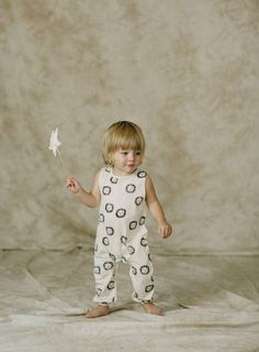 A whole pride of happy lion faces on a vanilla sleeveless jumpsuit. Snaps at inseam and back for easy dressing and diapering. See also Lions Romper and Lions Basic Tee. - Materials: 100% Cotton slub j
