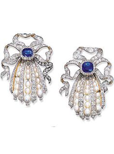 A PAIR OF IMPRESSIVE DIAMOND, SAPPHIRE AND PEARL BROOCHES  Each designed as old mine-cut diamond ribbon bows to the central cushion-shaped sapphire suspending four graduated old mine-cut diamond tassels with graduated pearl tassel spacers, each with a floral terminal (with concealed pendent hoop), circa 1910.