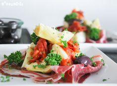 Tomates confitados con jamón ibérico y alcachofas
