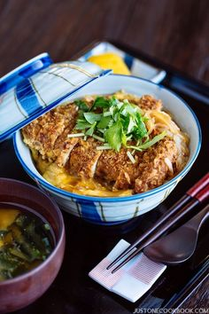 Juicy deep-fried pork cutlet and runny egg cooked in a savory and sweet dashi broth and placed over hot steamed rice, this Baked Katsudon recipe will be your new favorite weeknight meal! Japanese Rice Bowl, Japanese Dishes, Japanese Food, Easy Japanese Recipes, Asian Recipes, Katsudon, Pork Cutlets, Pork Cutlet Bowl, Eat This