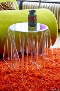 """""""Invisible side table"""" Danish designer works John brauer, Essey, Illusion, produced with a 3 mm acrylic."""