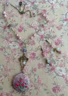 Polymer Clay Necklace Set .. Using a B'sue bezel .. pink & light purple glass beads .. 2 different sizes of crystals and brass chain .. Designed by .. Jann Tague .. Clever Designs .. https://www.facebook.com/#!/JewelsByJann