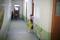 A North Korean boy looks on as he prepares for a music drill at a nursery school  in the northeastern North Korean border town of Sinuiju on December 15, 2012.