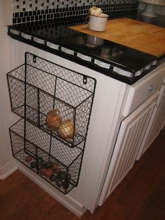 Metal baskets for onion and potato storage.