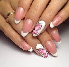 Wonderful looking butterfly nail art design in and French tips. The white French tips make the design look elegant and the pink butterfly on top of the pure white background accentuates it even more.