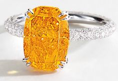 A rare and exquisite fancy vivid orange diamond ring. The center stone is 4.19 carats and the white gold setting is embellished with  brilliant-cut diamonds.   Via Diamonds in the Library.