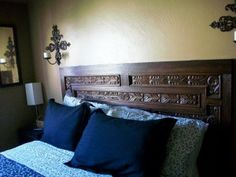 Using an old, carved wood door as a headboard