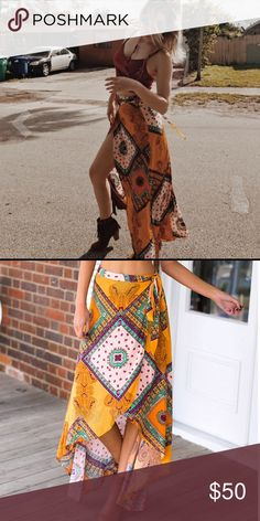 """Boho asymmetrical festival wrap skirt BRAND NEW BOHO WRAP SKIRT WITH TIE STRAPS AND A STUNNING ASYMMETRICAL HEM LINE. pair with your favorite crop top and choker for the hottest look this season! sizes: S-XL. small- waist 23.6""""  medium- waist 25.1""""  large-  waist 26.7"""" xlarge-  waist 28.3"""".. summer 17 bohemian inspired skirt perfect for festivals or going out. Polyester/ Cotton blend. self tie. beautiful bohemian inspired print. gorgeous colors. hand wash cold water. fast shipping! **no…"""