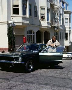 Steve McQueen in Bullitt classic Ford Mustang GT 390 on set San Francisco intersection of Broadway & Taylor. Great rare image of the legendary star and ca Steve Mcqueen Bullitt Mustang, Mustang Bullitt, Mustang Fastback, Mustang Cars, Ford Mustangs, Steve Mcqueen Style, Steve Mcqueen Cars, Steeve Mcqueen, Automobile
