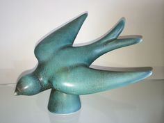 Ceramic swallow figure by Gunnar Nylund for Rörstrand, 1960s.  Solstice tree topper?