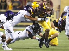 Arizona State wide receiver Jaelen Strong runs for a first down against Weber State during the season opener on Thursday, Aug. 28, 2014, at Sun Devil Stadium in Tempe, Ariz.