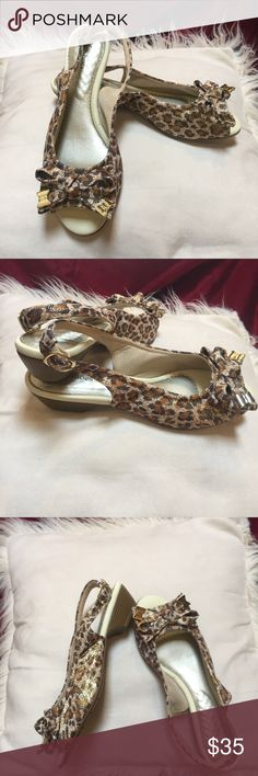 NWT Leopard Print Peep Toes with Sling Back NWT.  These ferocious kitten heels are anything but kittens in the style kingdom.  Featuring sassy sling backs, peep toes, bow detail with gold toned metal ends and all wrapped up in a metallic leopard print.  Day or night, there's a new queen of the jungle.  Made in Brazil  ~SIZING~  USA- 8/ 8.5 European- 39 Brazilian- 37 Latin- 38 Ella Fashion Shoes
