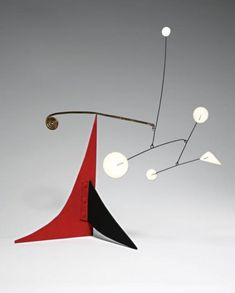 Alexander Calder - Untitled (Five White and Brass Spiral on Red and Black).     Painted sheet metal and wire standing mobile.